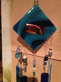 Fused glass wind chime in shades of sparkling blue