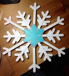 Popcicle stick snowflakes for the trees in my front yard, painted with outdoor paint, and used some leftover, cheap, wooden ornaments for the center, assembled with hot glue