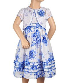 This Youngland ensemble is a stylish addition to her wardrobe. Made of light textured cotton, the dress features a tank bodice, button placket and sash tie in back, vintage-inspired floral print, and ruffle trim throughout. The matching crochet shrug has a 1-button closure, contrast picot trim, and a flower accent at the shoulder. #cookieskids #girls #fashion #dresses