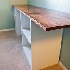 Extend the bookcases to the ends and this will be a great table behind the couch and give me storage and workspace for my crafting corner.