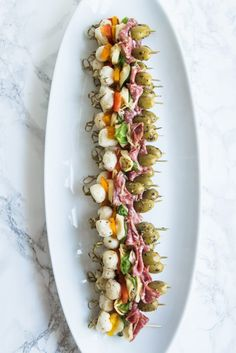 Need great party appetizers? These antipasto skewers are a quick easy appetizer recipe sure to wow your guests! Get the details at The Sweetest Occasion Antipasto Skewers, Skewer Appetizers, Skewer Recipes, Italian Appetizers, Appetizers For Party, Canapes, Antipasti Platter, Italian Antipasto, Antipasto Salad