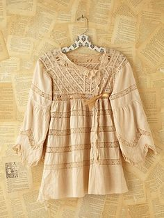I love this e-store's line of vintage looking clothes.  I would definitely wear this!