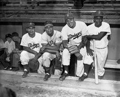 Major league baseball players Roy Campanella, Larry Doby, Don Newcombe, and Jackie Robinson meet at the 1949 All-Star Game. They were the first African American all-stars