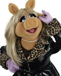Miss Piggy,I wanted to be her when I grew up,still love her now,she has attitude :)