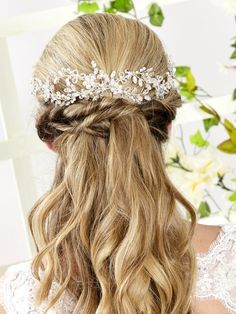 Beautiful beaded flower hair vine with pearls & crystals that give the look of climbing Jasmine. Looks great in a half up hair style as shown on the model, at the top of a veil or pinned in a low updo. Comes attached to a mini hair comb to secure into hai