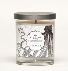 """Sea Mist scented soy candle by Witch City Wicks: If you close your eyes, you can imagine yourself down by the ocean, hearing the waves crash on the shore as the gentle breeze blows the mist on your face. Invigorating, soothing, relaxing. The """"Curiosities"""" collection label art work is inspired by modern curiosities and nature. 10% off with promo code PIN10"""