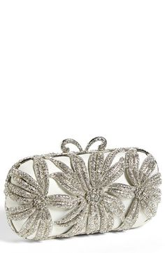 Sondra Roberts 'Flower' Minaudiere available at #Nordstrom $298. Bridal-white satin sets the stage for the exquisite, crystal-set flowers that encapsulate this seriously stunning clutch. A decadent conversation piece and aisle-worthy accessory. Magnetic closure. Interior wall pocket. Drop-in chain strap. Satin/glass crystals. By Sondra Roberts; imported.
