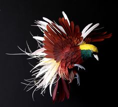 Diana Beltran Herrera hand-makes the paper birds by building up layers to form the base structure, then glues on delicate feathers that are ...