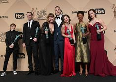 Julie Lake looking stunning in her Matthew Christopher gown, with the cast of Orange is the New Black in their big win at the 2017 SAG awards
