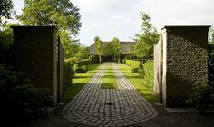 Fabulous driveway of cobblestone and grass