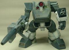 ツヴァーク 形式番号:XATL-01-DT 秘密結社が主にクエント星で使用していた劇中唯一のライト級AT。両腕に11ミリ3連装機関銃を内蔵し、手首が折り曲がって銃口が現れる。足には専用サンドローダーを装着可能。装甲は特殊プラスチックを使用し軽量化されている。その他の武装としてX-SAT-05ソリッドシューターを用いるときもある。両腕に火器を内蔵した関係でアームパンチの装備はなく、格闘戦能力は低い。脚部が短く、ATの標準機能ともいえる降着機能もないが、機体そのものが小型であるため、搭乗の際も特に不便にはならず、コクピットも体躯が2 mを越すクエント人でも搭乗可能。