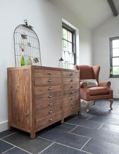 Add some rustic warmth to your kitchen, office, bathroom or lounge with this stunning Scrubbed Pine Cupboard. Its clever design looks like a set of drawers but it is actually a generous sized cupboard with 2 drawers and 2 larger areas with a shelf.  With beautiful metal handle detail. Put 2 or 3 together to make a fabulous sideboard for your workspace or kitchen.