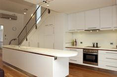 55 Amazing space-saving kitchens under the stairs