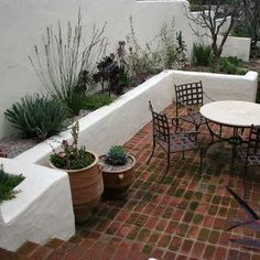 Retaining wall for a courtyard space - will use smooth concrete walls instead