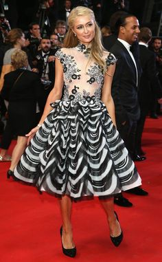 Paris Hilton rocks a full-skirted black and white dress with a sheer top at Cannes! Love it!