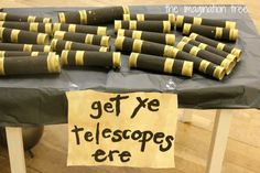 On arrival there was a table full of cardboard tube telescopes so that each child could collect one to use in some prate play! To make these I simply painted lots of wrapping paper rolls with black paint then added some gold trim with more paint once dry.