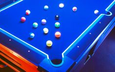 Glow in the dark pool table and balls