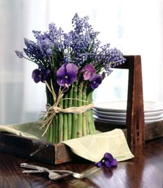 For supplies and directions for making this asparagus arrangement go to': http://www.goodhousekeeping.com/home/decorating-ideas/tips/g856/flower-produce-arrangements-0501/?slide=1