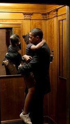 President Obama with his daughter Sasha, White House elevator