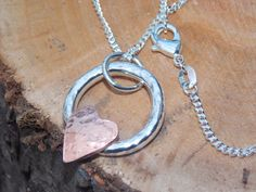 Beautiful and unusual textured 925 solid sterling silver pendant with small textured copper heart.