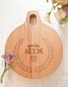 Custom Mothers Day Engraved Wood Cutting Board 9x11 Round Personalized by AHeirloom. $36.00, via Etsy.