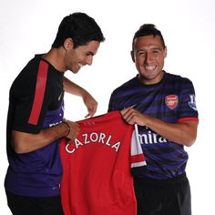 New Arsenal transfer signing Santi Cazorla with Mikel Arteta.