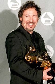 March 1995: Bruce Springsteen holds his four Grammy awards  for Song of the Year, Best Male Rock Vocal Performance, Best Rock Song and Best Song Written specifically for a Motion Picture or TV for his song 'Streets of Philadelphia'