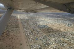 An aerial view of the world's largest refugee camp, Dadaab Refugee Crisis, Refugee Camps, Future Transportation, East Africa, Global Warming, Aerial View, Ethiopia, Marketing Digital, Solar Power