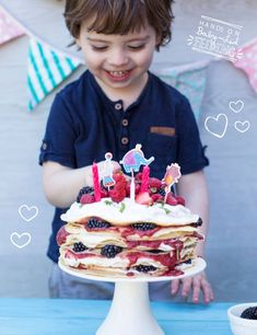 Super cute breakfast for baby led weaning. Home page banner recipe image. Baby Birthday cake from Baby led feeding. Oscars birthday cake for baby led weaning. This pancake cake is staked full of berries, coconut ice cream and raspberry chia jam. Completely refined sugar free blw recipe for baby birthday cake. These pancakes are full of yummy goodness. Packed with nutrients and goodness. From Aileen Cox Blundell Baby Led Feeding Cookbook.