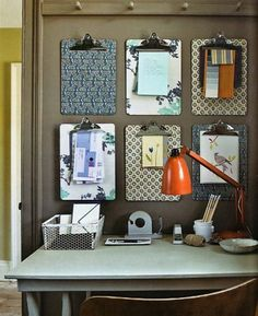 You think Martha Stewart got this idea from Lotta Jansotter's studio tour?  Maybe...this month, Martha Stewart Living showcased this idea with an extra step: covering the clipboard's masonite backing with dainty decorative paper and wallpaper with the help of découpage glue.  Not a bad way to introduce some patterns to a home office...