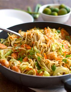 Stir Fried Noodles with Shrimp and Vegetables {Filipino Pancit Canton} •1 lb. raw, tail-off shrimp •3 tablespoons oil •3 cloves garlic •1 onion •1 head green cabbage •2 large carrots •8 ounces dry pancit canton noodles •3 cups chicken stock •2 tablespoons soy sauce •1 tablespoon fish sauce •calamansi (or lime) juice to taste •sliced green onions for topping