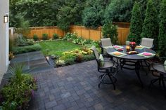like the way the plants surround the deck and fence via houzz.com