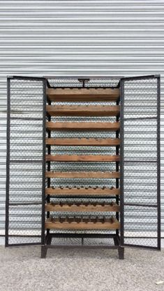 BRAND NEW INDUSTRIAL BORDEAUX CAGE WINE RACK Made from recycled Elm wood and iron steel to convey that Industrial rustic look Holds 72 wine bottles ..., 1054067994