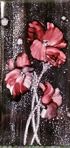 Sold. Flower in alcohol ink by tina on 3x6 tile. Black spritzed back ground, red blended. By Tina SOLD