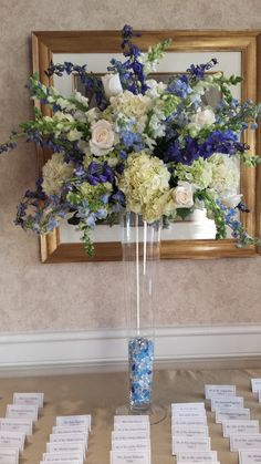 tall arrangement for the escort card table