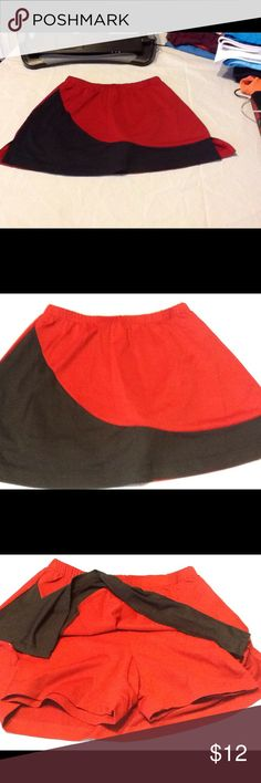 LBH tennis skirt active wear Red and black LBH tennis skirt with built in shorts underneath and one pocket for spare tennis balls, just one ball will fit lol. LBH Skirts
