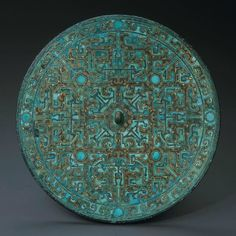 Inlaid Mirror. Chinese, Warring States, 4th - 3rd century B.C. Bronze, inlaid with Gold and Turquoise. Diameter: 7 inches (18 cm). Phoenix Ancient Art (New York, NY)