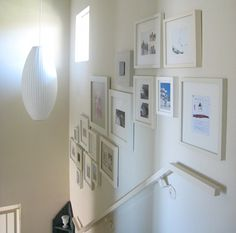 love this white frame art wall. of course the nelson pendant is rather nice, too.