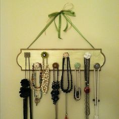 Necklace organizer using a wood plaque (from a craft store) and old drawer pulls. Fun to customize!