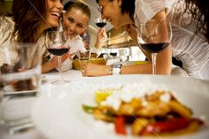 Happy friends at dinning table Royalty Free Stock Photo