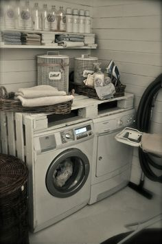 Pallet shelf over washer & dryer. Part of pallet also on wall. Love the baskets as well