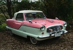 And I'm going in this 1958 Nash Metropolitan convertible. In pink!! My dream car.