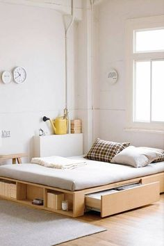 A bed that comes with its very own storage unit is small-space living 101. Whether you're opting for a trundle-inspired bed or a model that comes with a liftable base, there are a slew of options to consider. #Bedding