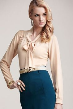 Elegant blouse, crafted in polyester, featuring long sleeve styling with button fastening cuffs, V neckline with strap tie up to the front, drape detail to the back.
