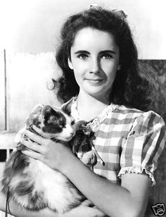 ELIZABETH TAYLOR with her cat at March 1945 Command Performance Radio Show