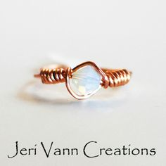 Beautiful and sparkly Opal Swarovski Crystal ring wrapped in copper wire.
