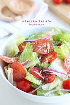 A simple, fresh Italian Salad is a great healthy meal idea! Crisp lettuce, spicy pepperoni, juicy tomatoes, and the perfect Italian dressing! | LoveGrowsWild.com #kraftsaladdressing #client