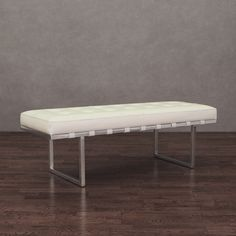 This trendy Andalucia bench features a modern stainless steel frame with a white leather button-tufted upholstery that will lend style and flare to your home. For added seating and contemporary style, this leather bench is the perfect combination.
