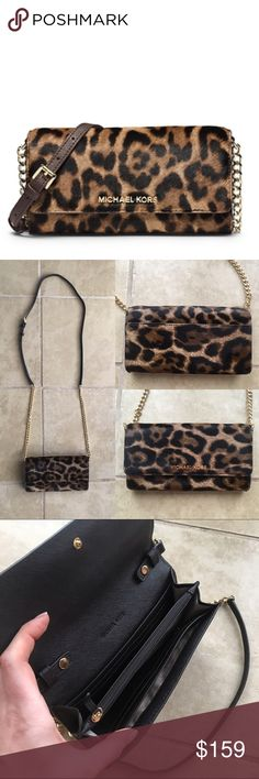 """Michael Kors Jet Set Leopard Calfhair Chain Wallet This compact leopard-print piece unfolds to a functional array of pockets and zip compartments, while a sleek chain and leather strap give you the freedom to wear it whichever way you want. Slip it into your favorite carryall by day, then wear it over your shoulder solo for night. Well loved and cared for. Only carried one week on holiday.       -100% Leather -Adjustable Strap: 23-25"""" -Interior: One Zip Coin Pouch, Four Open Pockets, 8 Card…"""