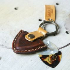 Gift for Him Personalized Vintage Rustic style Guitar pick case leather keyring - Hand Stitched - Man Dad Father's day. $16.50, via Etsy.